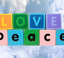 love on peace in wood play block letters against clouds by morrbyte