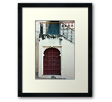 Stairs and Red Door Framed Print