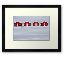 Four Red Cabins in Winter Framed Print