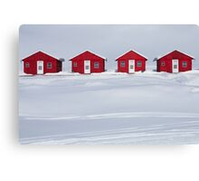 Four Red Cabins in Winter Canvas Print