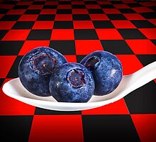 Blueberries on White Spoon against Checker Board Background by Randall Nyhof