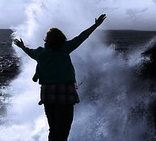 one woman with raised hands facing a wave and full moon on cliff edge by morrbyte