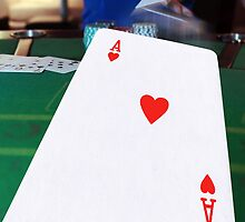 poker player throwing hand of cards by morrbyte