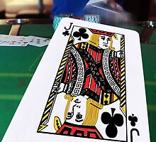 poker player throwing in the cards by morrbyte