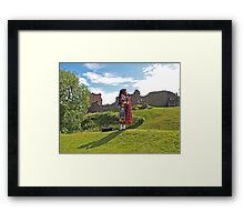 Piper at Urquhart Castle Framed Print