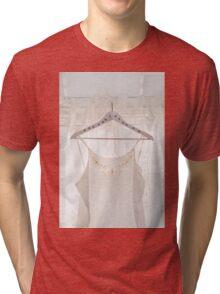 White dress on clothes hanger Tri-blend T-Shirt