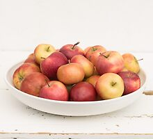 Small Danish apples in a big white bowl by Elisabeth Coelfen