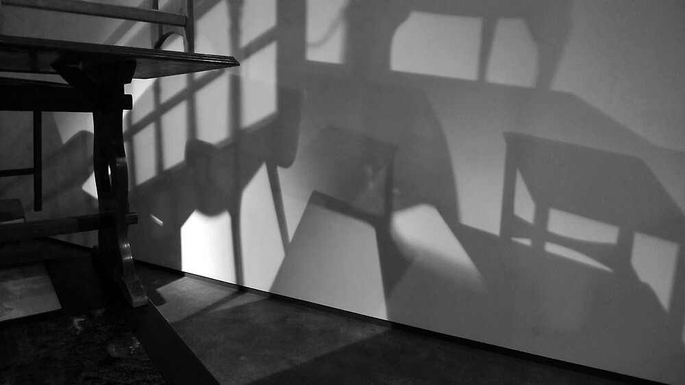 Table and chairs set on wall shadows by ragman