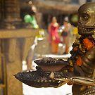 The sinister ashtray holder, Kathmandu  by John Spies