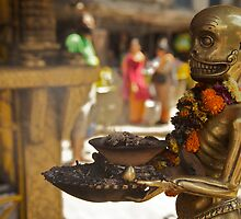 The sinister ashtray holder, Kathmandu  by John Spies