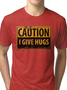 "Funny, ""CAUTION, I Give Hugs"" Realistic Metal with Rust Sign Tri-blend T-Shirt"