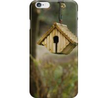 A birds' nest hangs from a tree iPhone Case/Skin