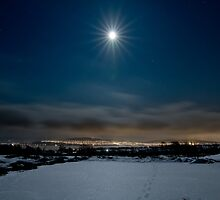 Full moon over Tromsø city by Frank Olsen