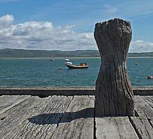 Bollard Boats and Blue Sky by Yampimon