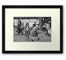Two Girls Cross a Busy Road Framed Print