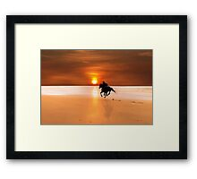 silhouette of a horse and rider galloping Framed Print