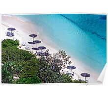 Sun umbrellas dotted along the white sand beach Poster