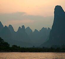 Li Jiang River at the limestone mountain peaks by Sami Sarkis