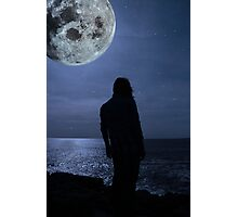 silhouette of a sad lone woman with a full moon on a cliff edge Photographic Print