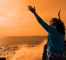 silhouette of lone woman facing a powerful  giant wave in sunshine by morrbyte