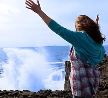 silhouette of lone woman in her 40s facing a giant powerful wave by morrbyte