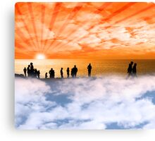 silhouette of people on the cliff edge above clouds Canvas Print