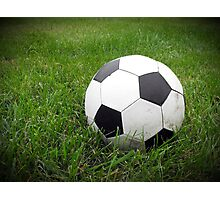 Old Soccer Ball in the Grass Photographic Print