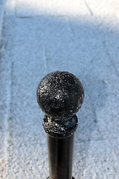 snow covered street bollard by morrbyte