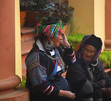 H'mong women resting after a hard day selling their trinkets by mechelle142