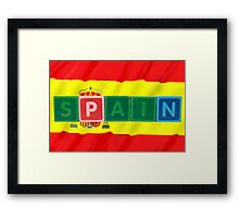 spain and flag in toy block letters Framed Print