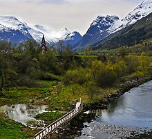 View up river to the new church, Olden, Norway by buttonpresser