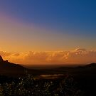 Sunshine spills onto the Glasshouse Mountains by Jaxybelle