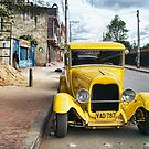 Yellow Classic Car by Maria  Gonzalez