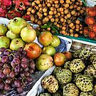 Variation of tropical fruits on stall at market by Sami Sarkis