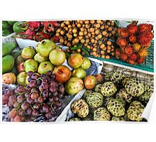 Variation of tropical fruits on stall at market Poster