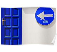 Street arrow sign and blue door on white wall Poster