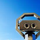 Binoculars on clear sky by Sami Sarkis