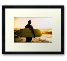 Surfer watching the waves Framed Print
