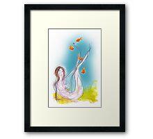 Mermaid with orange fish Framed Print