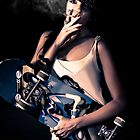 skater girl smoking a cigarette by Ryan Jorgensen