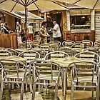 Chairs and Umbrellas by Maria  Gonzalez