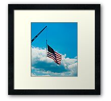 Flag pole on a Crane Framed Print