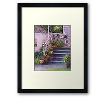Porch With Watering Cans Framed Print