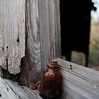 Brown glass bottle by ashley hutchinson