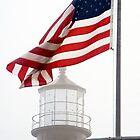 US Flag and Portland Head Light, Maine by Kenneth Keifer