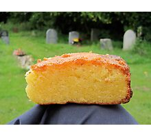 polenta cake and a well tended grave Photographic Print