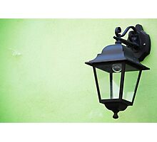 Lamp on a green wall Photographic Print