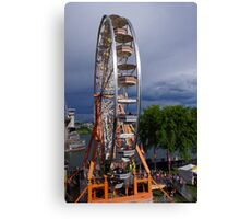 Ferris wheel by the bridge Canvas Print