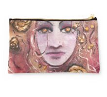 Ajleen floating in Gold Studio Pouch