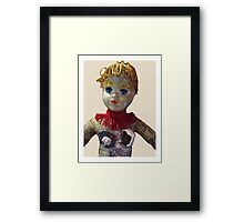 Interiority doll-head Framed Print